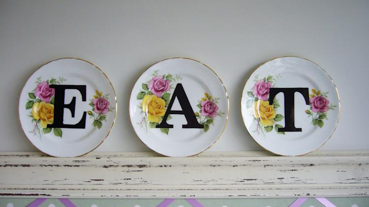 "In this March 2012 publicity photo provided by Angel in the North, the vintage-plate-decorating project upcycled with modern letter print described on the lifestyle blog ""angel in the north"" is shown in its completed form. The blog is run by Anna Nicholson of West Yorkshire, England. (AP Photo/Angel in the North, Anna Nicholson)"