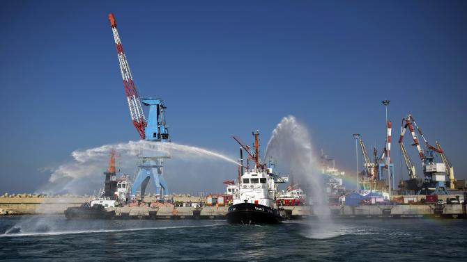 A tug boat sprays water during a drill at Ashdod port