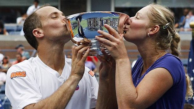 Ekaterina Makarova (R) of Russia and Bruno Soares of Brazil celebrate with their trophy after defeating Kveta Peschke of the Czech Republic and Marcin Matkowski of Poland at the US Open (Reuters)