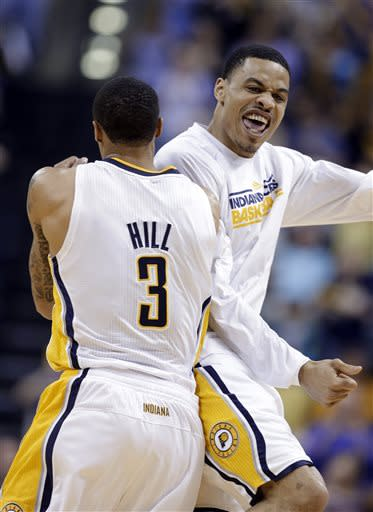 Indiana Pacers guard George Hill, left, and forward Gerald Green celebrate as the Pacers took the lead against the Cleveland Cavaliers late in the second half of an NBA basketball game in Indianapolis, Tuesday, April 9, 2013. The Pacers won 99-94