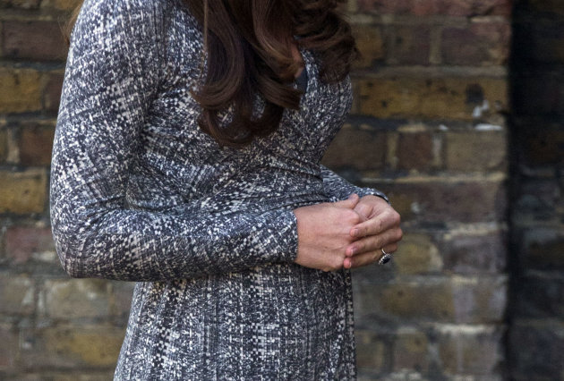 Britain's Kate the Duchess of Cambridge, who is pregnant and due to give birth in July,  arrives at Hope House, in London,  Tuesday, Feb. 19, 2013. As patron of Action on Addiction, the Duchess was vi