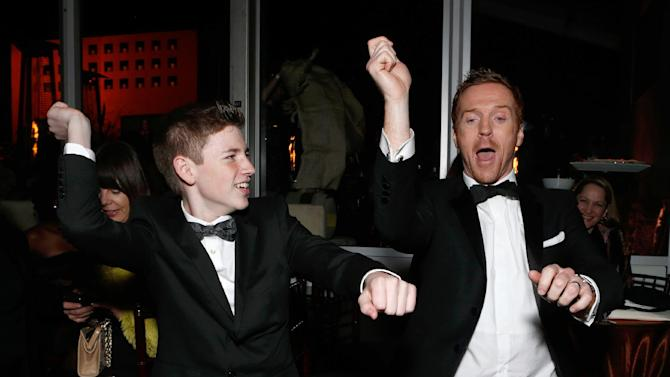 IMAGE DISTRIBUTED FOR FOX SEARCHLIGHT - Actors Jackson Pace, left, and Damian Lewis dance Gangnam Style at the Fox Golden Globes Party on Sunday, January 13, 2013, in Beverly Hills, Calif. (Photo by Todd Williamson/Invision for Fox Searchlight/AP Images)