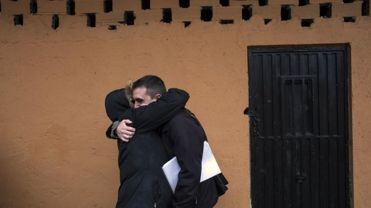 Antonia embraces her lawyer Rubio after learning that her eviction had been suspended in Madrid