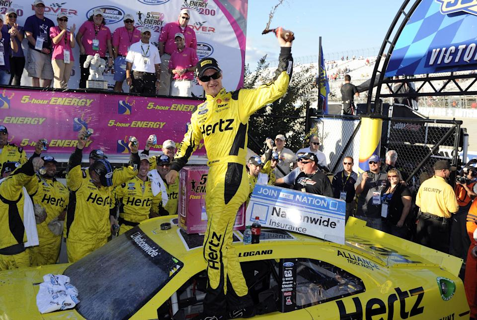 Joey Logano celebrates his win in the NASCAR Nationwide Series auto race, Saturday, Sept. 28, 2013, at Dover International Speedway in Dover, Del. (AP Photo/Nick Wass)
