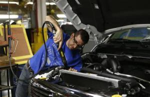 Chrysler assembly worker Kline works on a 2014 Dodge Ram pickup truck at the Warren Assembly Plant in Warren, Michigan