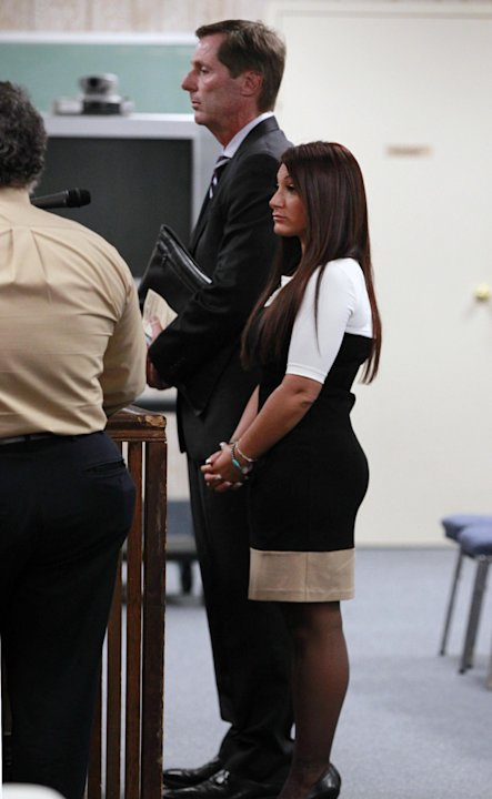 &quot;Jersey Shore&quot; cast member Deena Cortese, right, stands with her attprney Michael Pappa, center back,  during a hearing Tuesday, July, 3, 2012, in Seaside Heights, N.J.  Police arrested  Cortese on Ju