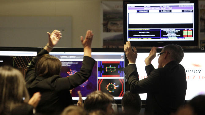 "FILE - In this March 30 2010 file picture s cientist of the European Organization for Nuclear Research, CERN, react in the SMS experiment control room at their headquarter outside Geneva, Switzerland. The world's largest and most powerful atom smasher goes into a 2-year hibernation in March 2013 , aiming to reach maximum energy levels that may lead to more stunning discoveries after hunting down the so-called ""God particle. But physicists at the European Center for Nuclear Research, known by its French acronym CERN, won't exactly be idle as the US $10 billion proton collider goes on hiatus for maintenance and retooling _ in preparation for unlocking more mysteries. There are still reams more data to sift through since the July discovery of a new subatomic particle called a Higgs boson and promises a new realm of understanding in subatomic science. (AP Photo/Anja Niedringhaus)"