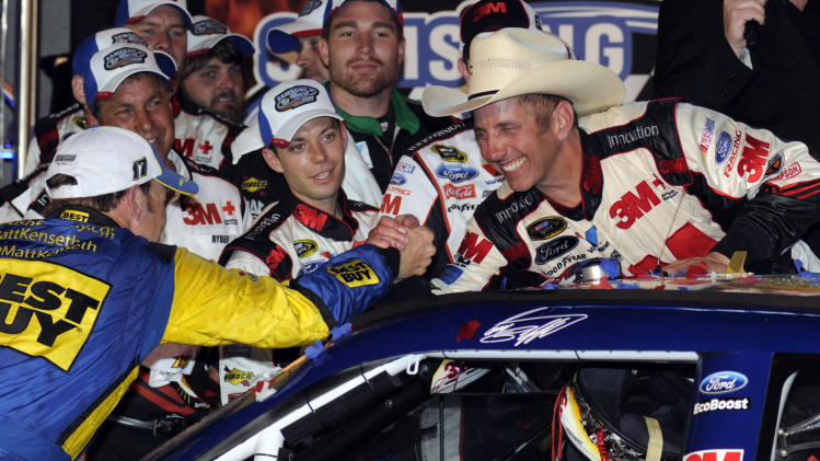 Greg Biffle, right, shakes hands with Matt Kenseth, left, after Biffle won the NASCAR Sprint Cup Series auto race at Texas Motor Speedway Saturday, April 14, 2012, in Fort Worth, Texas. (AP Photo/Larry Papke)