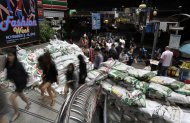 Tourists and locals visit a shopping mall fortified with sandbags in Bangkok, Thailand, Friday, Nov. 11, 2011. Thailand is once again in tourist turmoil as floods linger, but ever resilient industry unfazed. (AP Photo/Altaf Qadri)