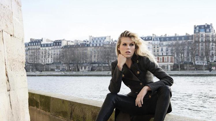 This undated image released by Ferragamo shows Alexandra Richards wearing a Ferragamo Varina shoe in black. (AP Photo/Ferragamo)