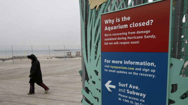 A woman walks past an entrance to the Wildlife Conservation Society's New York Aquarium in Coney Island, New York, Monday, March 25, 2013.  (AP Photo/Seth Wenig)