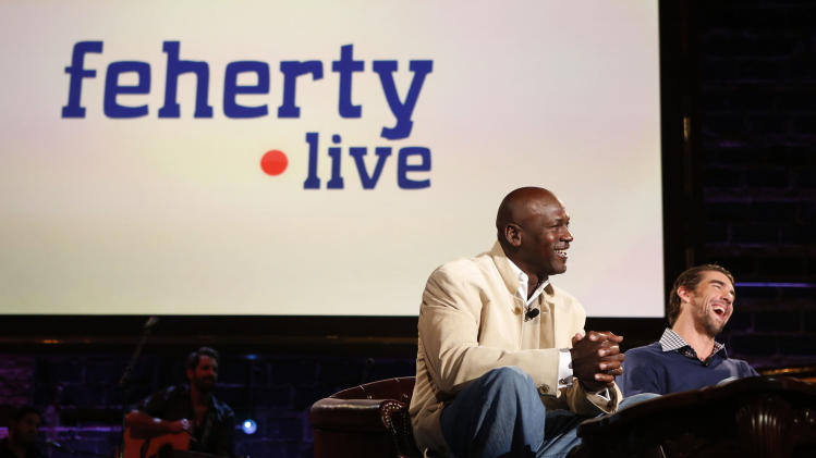 (L-R) Charlotte Bobcats owner Michael Jordan and Olympic Champion Michael Phelps as seen at Golf Channel's 'Feherty Live From the Ryder Cup', on Monday, September 24, 2012 at the Tivoli Theatre in Downers Grove, IL.  (Ross Dettman /AP Images for Golf Channel)