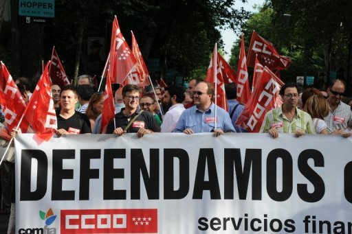 <p>People take part in a demonstration June 20, 2012 in Madrid, against government welfare cuts. A bailout of Spain's banks comes with strings attached and Madrid's efforts to cut its deficit must be monitored closely, a top European Central Bank official said on Thursday.</p>