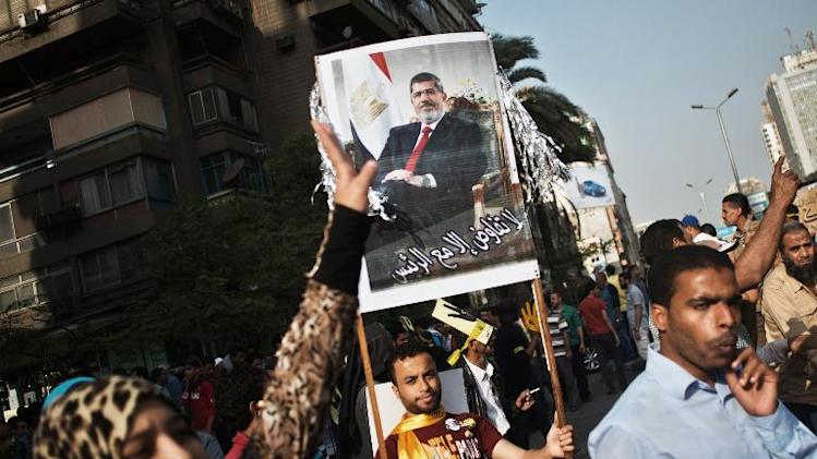 A female supporter of the Muslim Brotherhood and ousted president Mohamed Morsi takes part in a march through the streets of Cairo in his support on November 8, 2013