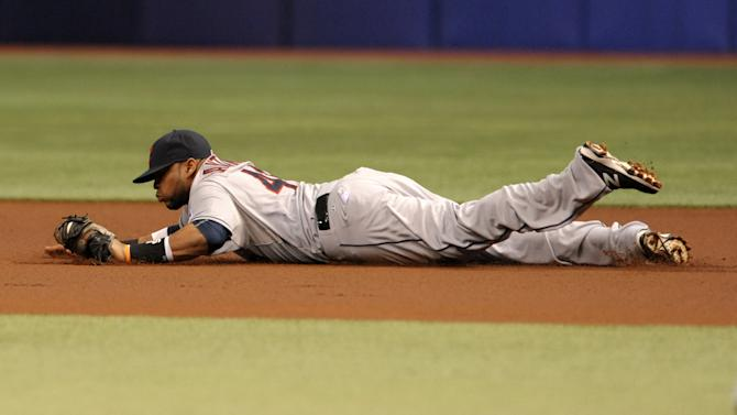 Cleveland Indians first baseman Carlos Santana makes diving stop on a ground ball hit by Tampa Bay Rays' Joey Butler during the first inning of a baseball game Wednesday, July 1, 2015, in St. Petersburg, Fla. (AP Photo/Steve Nesius)