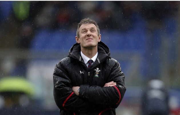 Wales' rugby union team head coach Howley looks as rain beofre their Six Nations rugby match against Italy in Rome