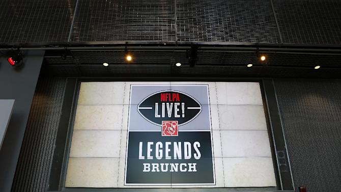 A general view of the NFLPA Legends Brunch logo is seen on a video board during the NFLPA Legends Brunch at the National World War II Memorial Museum on Sunday February 3, 2013 in New Orleans, Louisiana. (Aaron M. Sprecher/AP Images for NFLPA)