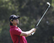 Australia's Jason Day watches after playing a shot on the 13th hole during the second round of the Australian PGA golf championship held at the Hyatt Regency, Coolum, Australia, Friday, Nov. 25, 2011. (AP Photo/Tertius Pickard)