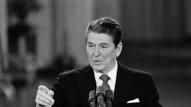 FILE - This April 4, 1984 black-and-white file photo shows President Ronald Reagan faces reporters at the beginning of a news conference in the East Room of the White House in Washington. Second presidential terms are never easy. More often, they're fraught with peril, frequently marred by scandal, failure, hubris, and burnout and souring relations with Congress. (AP Photo/Ira Schwarz, File)