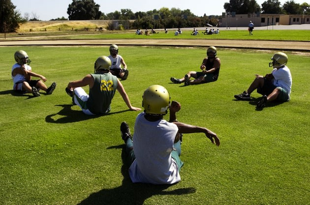 Rio Americano players stretch before a recent practice — Sacramento Bee