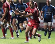 Toulon's Frederic Michalak passes the ball during their French Top 14 rugby union match against Montpellier at the Yve du Manoir stadium in Montpellier, southwestern France. Toulon won 32-25