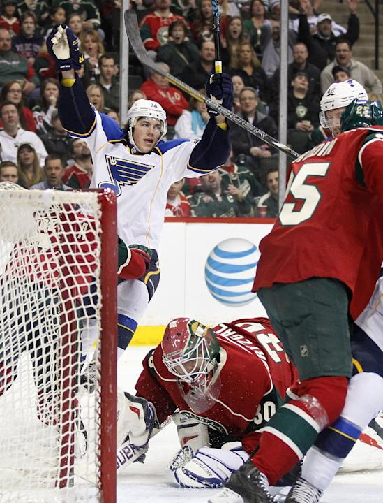 St. Louis Blues right wing T.J. Oshie (74), center, celebrates a goal on Minnesota Wild goalie Ilya Bryzgalov (30) during the first period of their NHL hockey game Sunday, March 9, 2014 in St. Paul, M