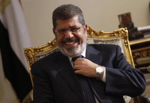 Egypt's President Mursi laughs during his meeting with U.S. Secretary of State Kerry at El-Thadiya presidential palace in Cairo