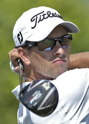 Adam Scott, of Australia, follows the flight of his tee shot on the ninth hole during the third round of the Arnold Palmer Invitational golf tournament at Bay Hill Saturday, March 22, 2014, in Orlando, Fla. (AP Photo/Willie J. Allen Jr.)