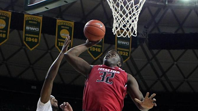Texas Tech forward Norense Odiase (32) drives to the basket past Baylor forward Royce O'Neale (00) in the first half of an NCAA college basketball game, Friday, March, 6, 2015, in Waco, Texas. (AP Photo/Jerry Larson)