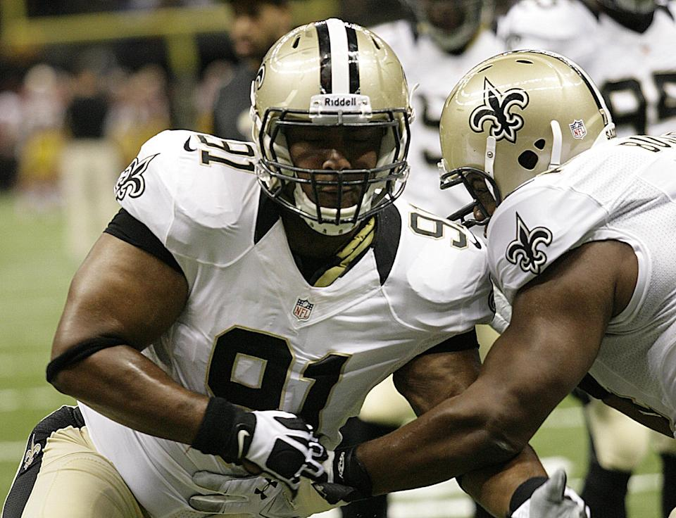 New Orleans Saints defensive end Will Smith (91) warms up before an NFL football game against the Washington Redskins at the Mercedes-Benz Superdome in New Orleans, Sunday, Sept. 9, 2012. (AP Photo/Matthew Hinton)
