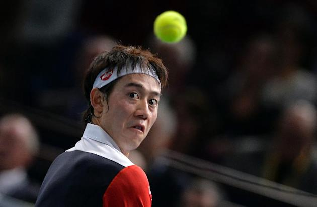 Japan's Kei Nishikori returns a shot during a tennis tournament at the Bercy Palais-Omnisport (POPB) in Paris, on October 31, 2013