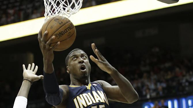 Indiana Pacers center Roy Hibbert (55) shoots over Atlanta Hawks center Johan Petro (10) during the first half in Game 4 of their first-round NBA basketball playoff series game, Monday, April 29, 2013 in Atlanta. (AP Photo/John Bazemore)