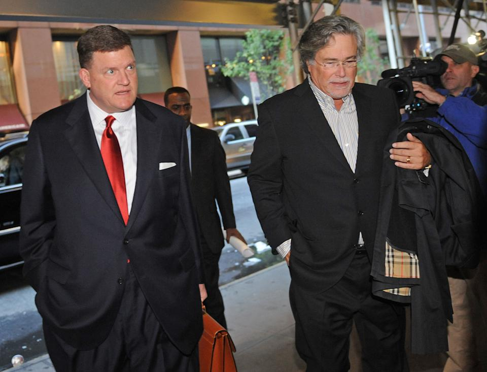 Oklahoma City Thunder owner Clay Bennett, left, and Miami Heat owner Micky Arison arrive at a midtown hotel where NBA labor talks are scheduled to resume, Saturday, Nov. 5, 2011, in New York. (AP Photo/ Louis Lanzano)