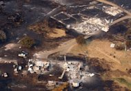 <p>This aerial photograph taken on January 5, 2013, shows the devastation to property between Dunalley and Boomer Bay, in Tasmania, after bushfires swept through the area.</p>