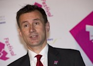 The British minister due to oversee the Olympics has insisted he will stay in his role amid fresh pressure for him to quit over alleged collusion with Rupert Murdoch&#39;s companies. A spokeswoman for Jeremy Hunt (pictured), whose role as minister for culture, media and sport includes responsibility for the Games, said he would &quot;vindicate&quot; his position when he appears at an inquiry into press ethics