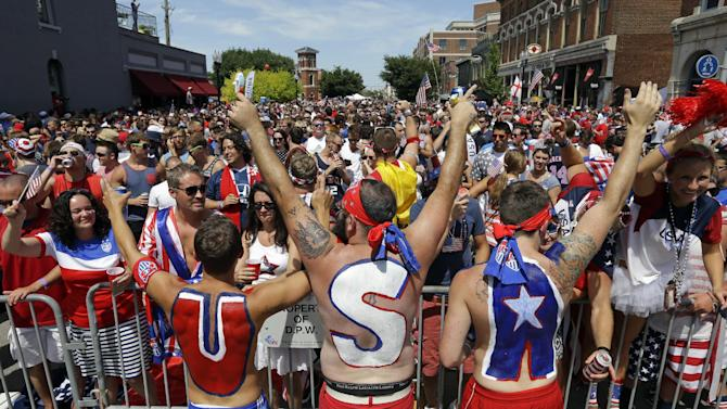 United States fans cheer before the start of the World Cup soccer match between the United States and Belgium at a viewing party in Indianapolis, Tuesday, July 1, 2014. (AP Photo/Michael Conroy)