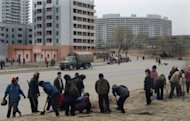 Workers plant flowers by a Pyongyang street in April 2012. The fact that the KCNA report on the session contained no mention of economic reform might suggest Pyongyang is still wary of moving beyond the trial stage towards institutionalised change, analysts said