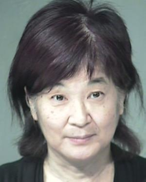 Yukari Mihamae, 61, is seen in this undated booking photo in Phoenix provided by the Maricopa County Sheriff's Office. Authorities say the Colorado woman who allegedly groped a female Transportation Security Administration agent at Phoenix's international airport on Thursday, July 14, 2011 is facing a felony count of sexual abuse. (AP Photo/Maricopa County Sheriff's Office)