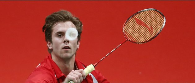 Denmark's Jorgensen plays a shot during his men's singles match against Taiwan's Hsueh in Kuala Lumpur