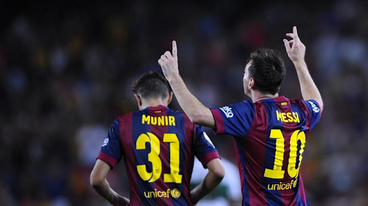 FC Barcelona's Lionel Messi from Argentina, right, reacts after scoring against Elche during a Spanish La Liga soccer match at the Camp Nou stadium in Barcelona, Spain, Sunday, Aug. 24, 2014. (AP Photo/Manu Fernandez)