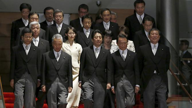 Japan's Prime Minister Abe leads his cabinet ministers as they prepare for a photo session at his official residence in Tokyo