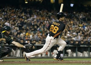 San Francisco Giants' Buster Posey (28) swings for an RBI single off Oakland Athletics' Tommy Milone in the third inning of an exhibition spring training baseball game Thursday, March 28, 2013, in San Francisco. (AP Photo/Ben Margot)