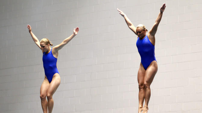 Abby Johnston, left, and Kelci  Bryant begin a dive in the women's three-meter springboard synchro final at the U.S. Olympic diving trials on Thursday, June 21, 2012, in Federal Way, Wash. The two won the event. (AP Photo/Elaine Thompson)