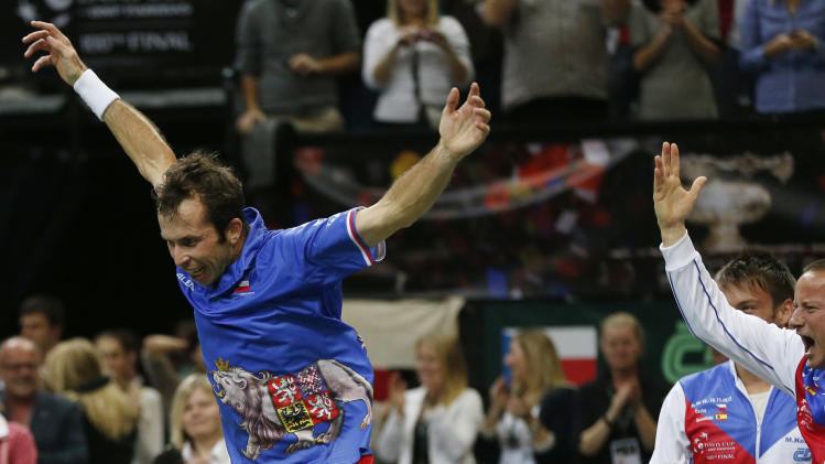 Czech Republic's Radek Stepanek celebrates after defeating SPain's Nicolas Almagro in their Davis Cup finals tennis singles match in Prague, Czech Republic, Sunday, Nov. 18, 2012. Czech Republic defeated Spain 3-2 and gained the Davis Cup trophy. (AP Photo/Petr David Josek)