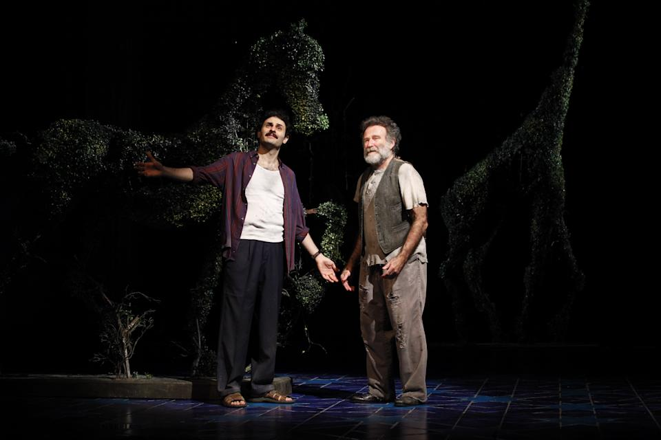 "In this undated theater publicity image released by Sam Rudy Media Relations, Arian Moayed, left, and  Robin Williams  are shown in a scene from ""Bengal Tiger at the Baghdad Zoo,"" at the Richard Rodgers Theatre in New York. (AP Photo/Sam Rudy Media Relations, Carol Rosegg)"