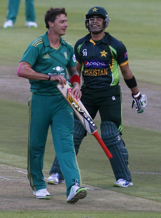 Pakistan's Umar Akmal laughs as South Africa's Dale Steyn jokingly takes his bat during their second Twenty20 cricket match in Cape Town,