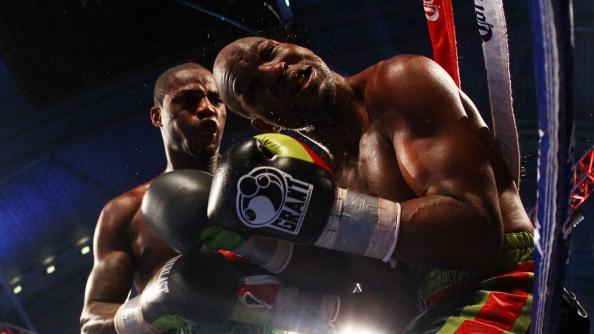Chad Dawson (grey and green trunks) lands a punch against Bernard Hopkins (black trunks) during their WBC & Ring Magazine Light Heavyweight Title fight at Boardwalk Hall Arena on April 28, 2012 in Atlantic City, New Jersey. (Photo by Al Bello/Getty Images)