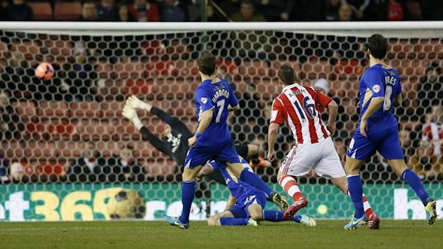 Leicester City's goalkeeper Kasper Schmeichel fails to deflect a goal by Stoke City's Charlie Adam (2nd R) during their FA Cup third round soccer match