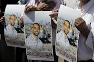 <p>Protesters in Jerusalem hold portraits of Samer Issawi, a Palestinian prisoner on hunger strike, on September 18, 2012. Thousands rallied in the West Bank's two largest cities on Monday in support of four long-term hunger strikers, as the Palestinians demanded tougher EU action to help their prisoners.</p>