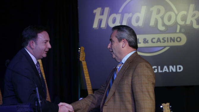 IMAGE DISTRIBUTED FOR HARD ROCK INTERNATIONAL - Eugene J. Cassidy, CEO of Eastern States Exposition, left, and Jim Allen, Chairman of Hard Rock International, shake hands as Hard Rock International's application is announced for Hard Rock Hotel & Casino New England at Eastern States Exposition in West Springfield, Mass., on Friday, Jan. 11, 2013. (Photo by Bizuayehu Tesfaye/Invision for Hard Rock International/AP Images)